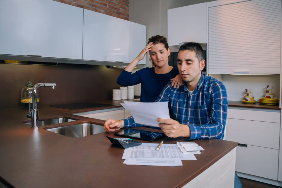 Unemployed young couple with debts reviewing their bank accounts - bankruptcy attorney